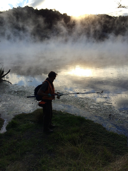 Matt Stott sampling Frying Pan Lake at Waimangu Volcanic Valley (one of the largest geothermal lake in the world!) – on the hunt for thermophilic amoebae.